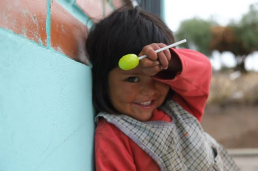 Clarita loves to be read to! Can you help us build reading corners in the libraries in Bolivia?