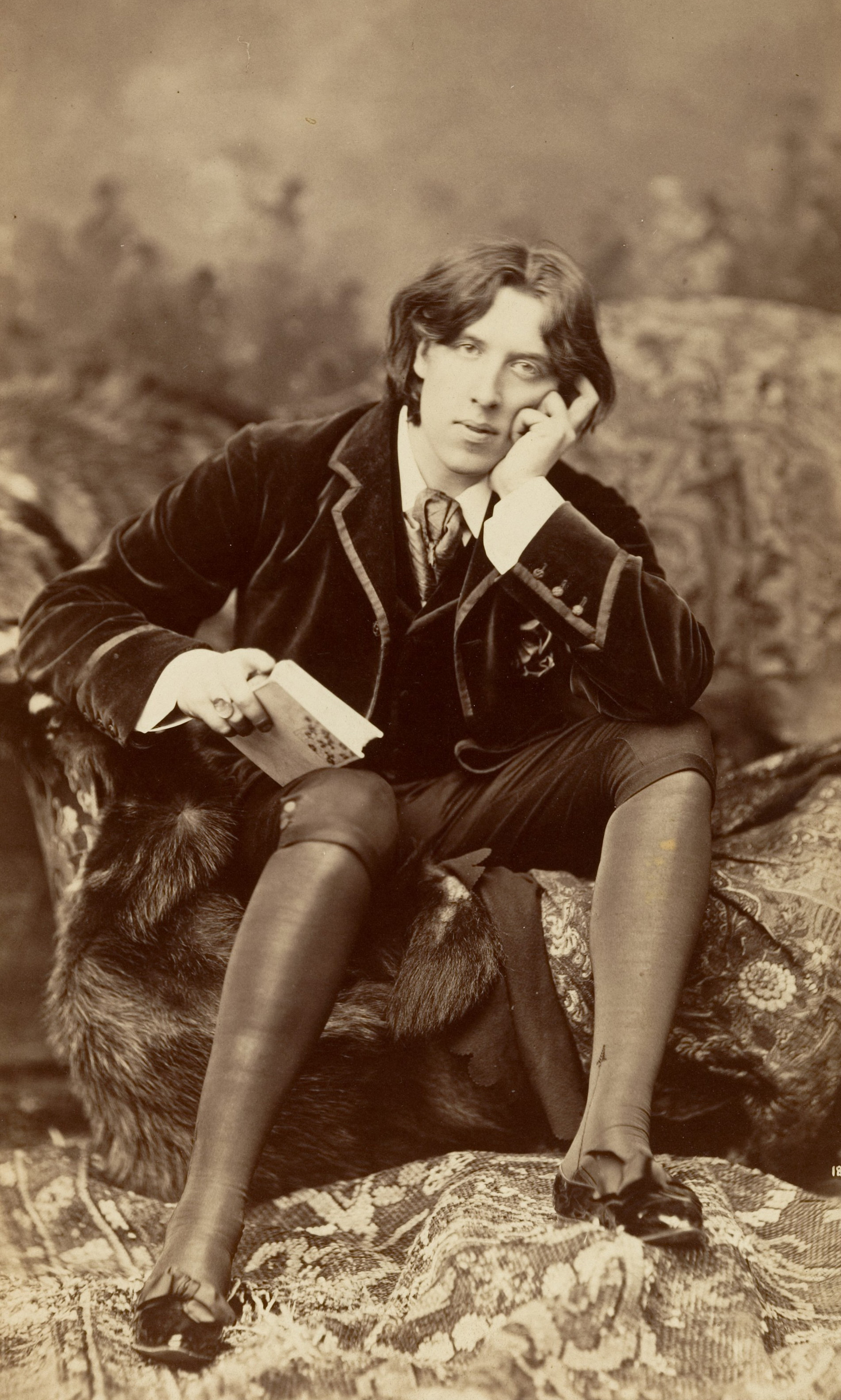 "Oscar Wilde, image taken by Napoleon Sarony. From ""Gathering Wilde-flowers"" on Biblio"